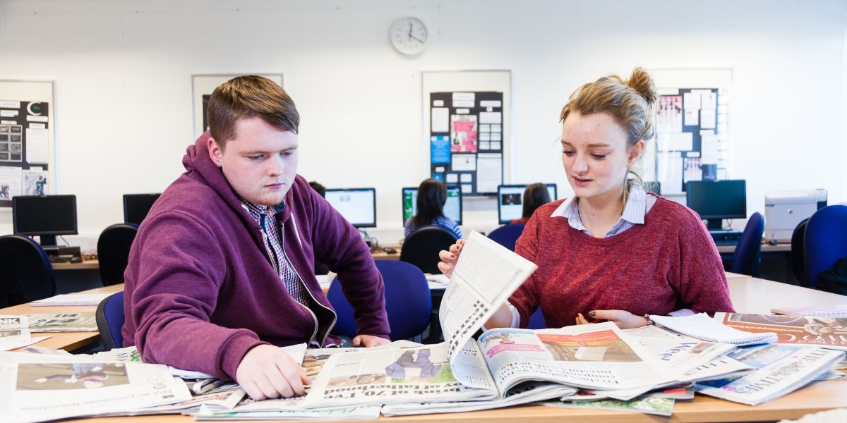 Media Students With Newspapers