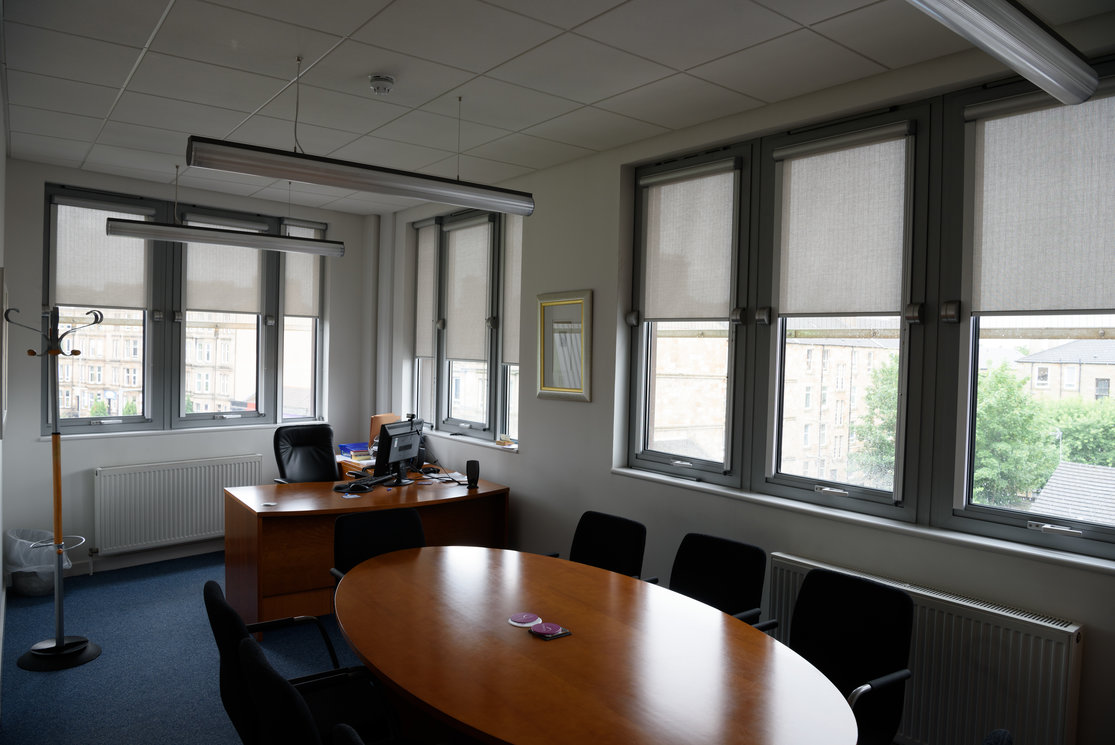 Langside corner office with meeting table gallery