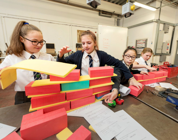 School pupils constructing with blocks in a classroom