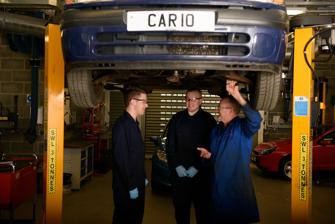 Automotive inspecting underneath car with lecturer %286%29 gallery